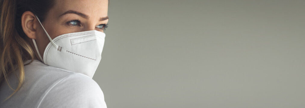 Young woman wearing  a facemask during coronavirus and flu outbreak. Virus and illness protection, home quarantine. COVID-19 concept