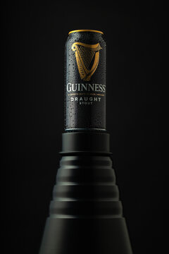 Dewy Guinness can on the black background.