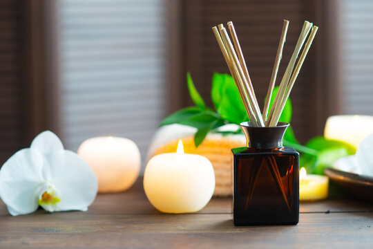 Spa background. Towel, candles, aroma sticks, orchid flowers and herbal balls. Massage, oriental therapy, wellbeing and meditation.