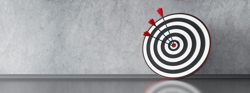 Zielscheibe mit 3 Pfeilen vor Steinwand