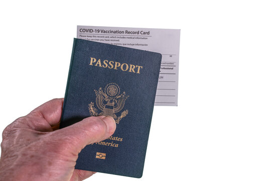 Senior man hand holding USA passport and vaccination certificate or record card for coronavirus