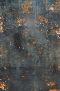 Grunge rusty dark metal sheet texture background