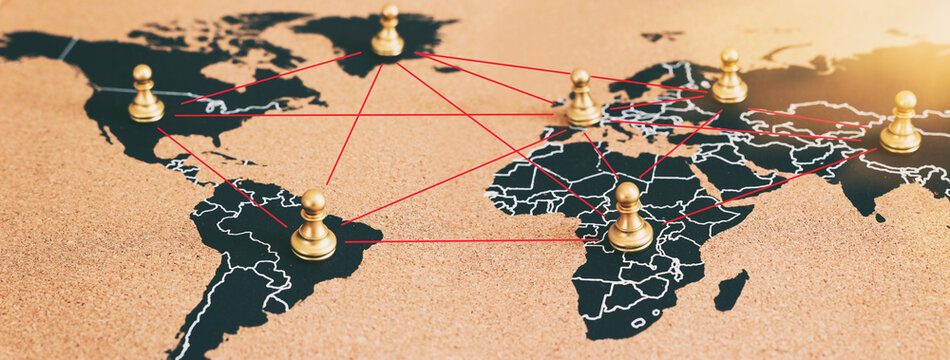 concept of geopolitics or worldwide economy. chess figures placed on map banner