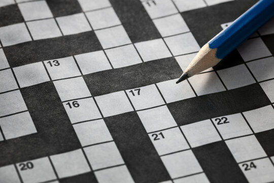 Solving a crossword puzzle with blue pencil