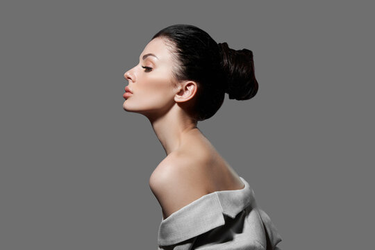 Perfect face profile woman, natural cosmetics for face care. Portrait of a fashion woman with a bunch of hair
