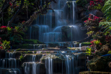 Wonderful waterfall in summer flowing at the tropical forest, Nice and amazing cascade, fantasy landscape