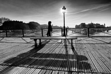 Woman silhouette with masked face on the bridge pont des Arts Fototapete