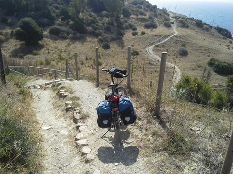 A ride on a touring bike on winding paths in the midday heat.
