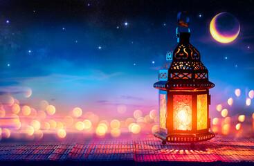 Obraz Muslim Holy Month Ramadan Kareem - Arabic Lantern With Burning Candle And Bokeh Glowing At Evening - Eid Ul Fitr - fototapety do salonu