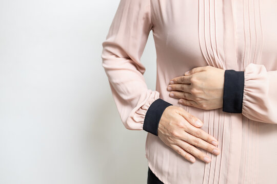 Asian woman patient with abdominal pain on right side belly,painful in abdomen,irritable bowel disease,lady girl holds under the ribs,stomach ache,cirrhosis of the liver disease,liver cancer concept