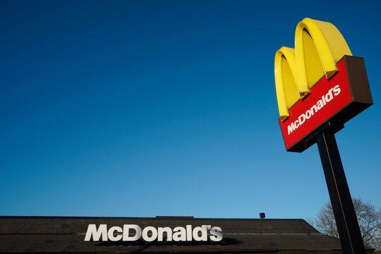 McDonalds logo on blue sky background