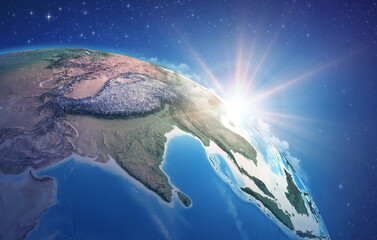 Fototapeta Sunrise through clouds, upon a high detailed satellite view of Planet Earth, focused on South Asia, Himalayas and India. 3D illustration - Elements of this image furnished by NASA