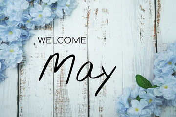 Fototapeta Welcome May text and blue flower decoration on wooden background obraz