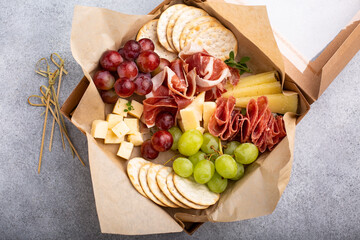 Charcuterie board in a box with cheese and meat