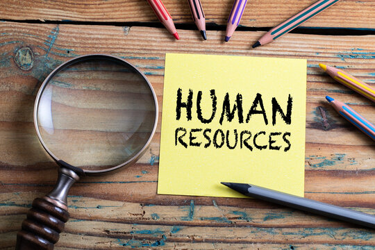 Human Resources. Search, research and analysis concept. Magnifying glass on a wooden table