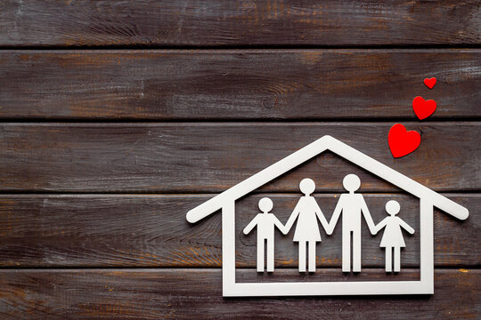 Family figure in house with heart. Happy family, protection and insurance concept