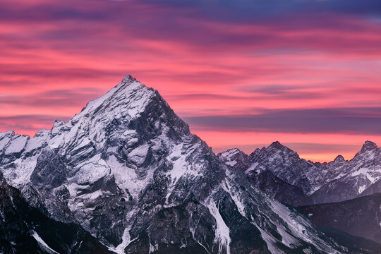 Pink sunset on Antelao mountain in winter with snow, Dolomites, Trentino-Alto Adige, Italy