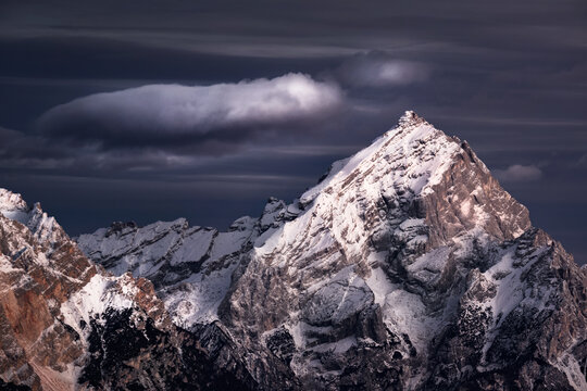 Antelao mountains with snow and a lonely cloud, Dolomites, Trentino-Alto Adige, Italy