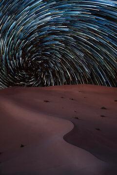 Vortex star trail in the Rub al Khali desert in Oman, Rub al Khali, Oman, Middle East