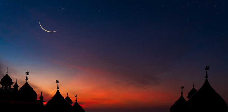 Crescent moon over dome mosques on twilight dusk sky, religious Ramadan month Islamic culture