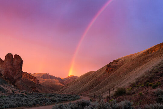 United States, Oregon, Rainbow above desert landscape at sunset