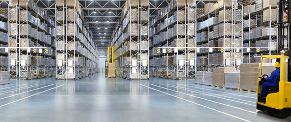 Obraz Huge distribution warehouse with high shelves and forklift with driver. - fototapety do salonu