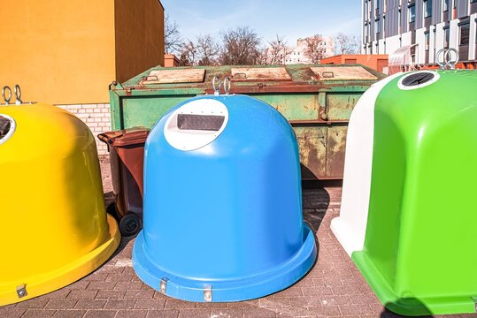 garbage cans on the street on a sunny day