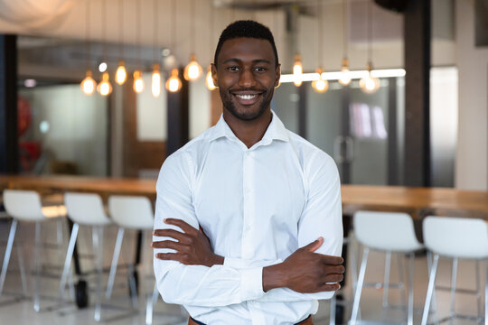 Portrait of happy casual african american businessman with arms crossed smiling to camera