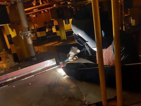 worker in factory welding welder