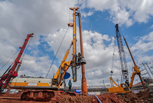 Industrial drilling rig machinery on building construction site.Drilling vehicle construction concrete piles on working