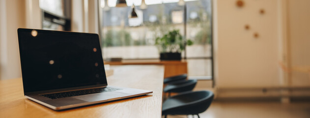 Laptop on boardroom table