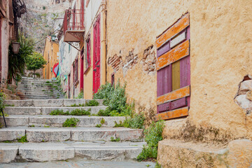 Stone stairs, old buildings walls Plaka, Athens Greece.