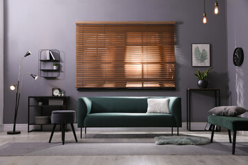Fototapeta Stylish living room interior with comfortable green sofa and cushion obraz