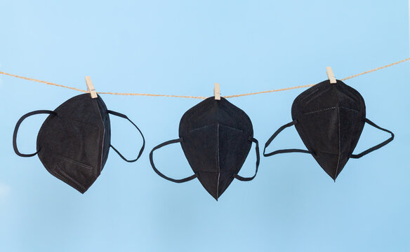 Protective fabric face masks hanging on clothesline