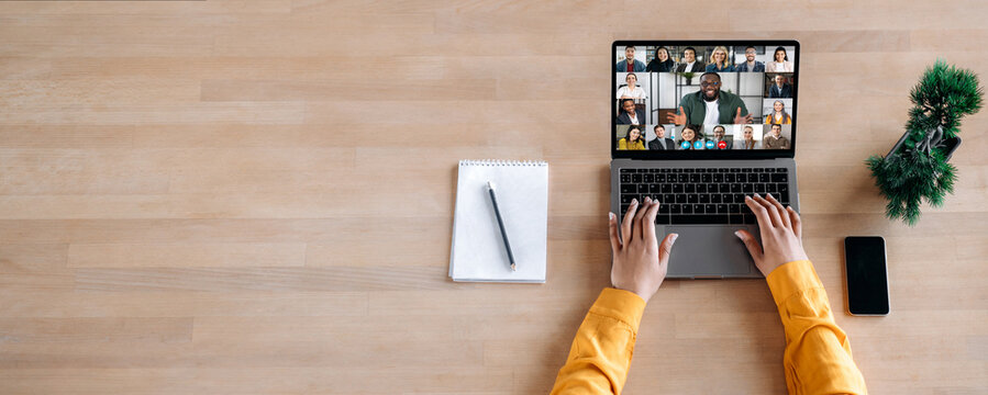Online business briefing, virtual meeting. Panoramic photo of laptop screen with webcam shots of multi ethnic business partners communicates from home by a video conference, online webinar. Copy space