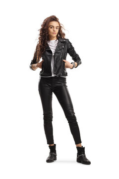 Full length portrait of a young trendy woman in a leather jacket posing