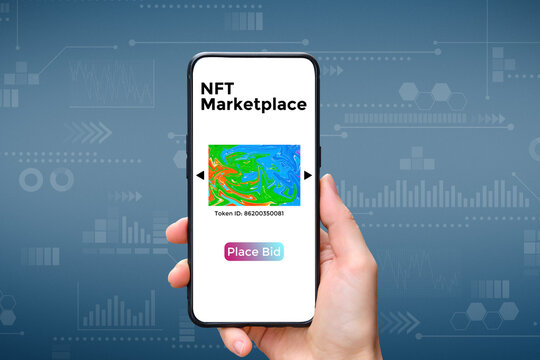 A hand holds a smartphone with an type of cryptographic NFT marketplace art with place bid.