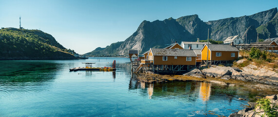 Wall Murals Graffiti View of the city of Rhine on the Lofoten islands, a beautiful bright landscape, yellow houses on the beach