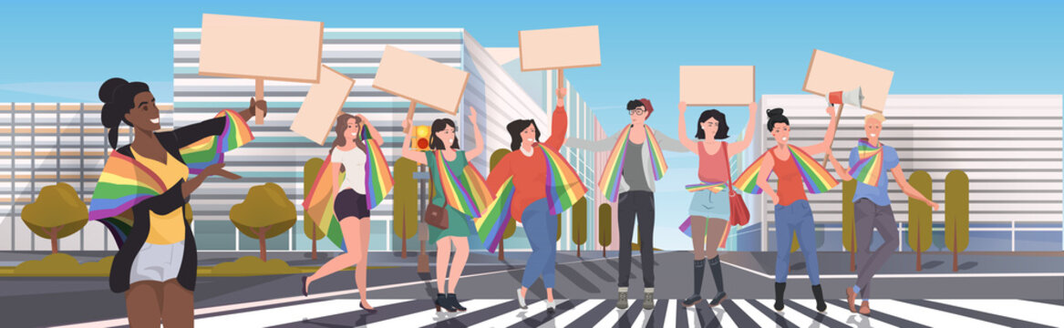 gays and lesbians with lgbt rainbow flags holding protest posters blank placards love parade pride festival demonstration concept cityscape background full length horizontal