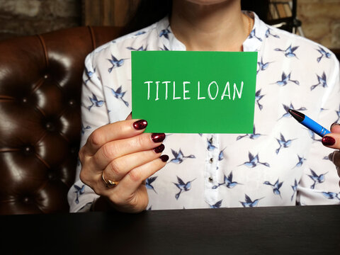 Business concept about TITLE LOAN with sign on the sheet. Conceptual photo showing a loan that requires an asset as collateral