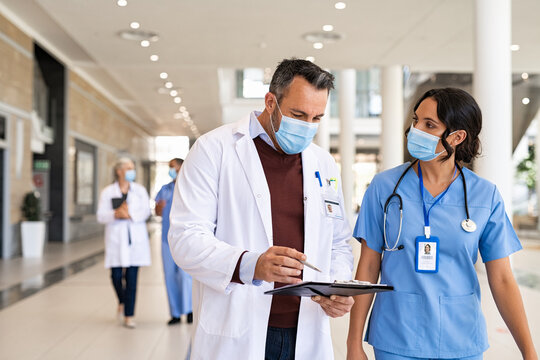 Mature doctor and nurse discussing patient case