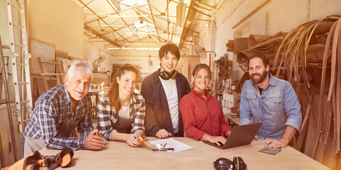 Fototapeta Apprentices and masters training to become craftsmen obraz