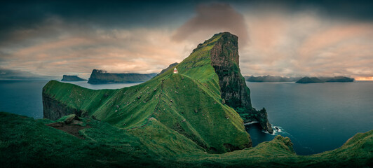 Panorama at Lighthouse with steep cliffs during sunset on Faroese island Kalsoy, Faroe Islands.