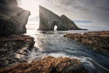 Coast and Drangarnier rock formations on Vagar, ocean and rocks in front, Faroe Islands.