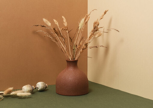 Vase with bouquet of dry grass