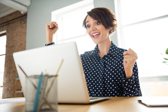 Photo portrait of business woman working with computer gesturing like winner happy on friday