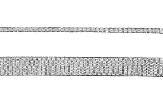 narrow and wide silver lurex ribbon on white background