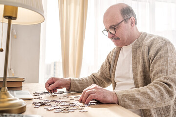 Senior caucasian man working on a puzzle Wall mural