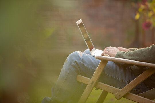 Man using laptop in garden