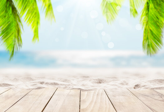Wooden table top on blue sea and white sand beach background.